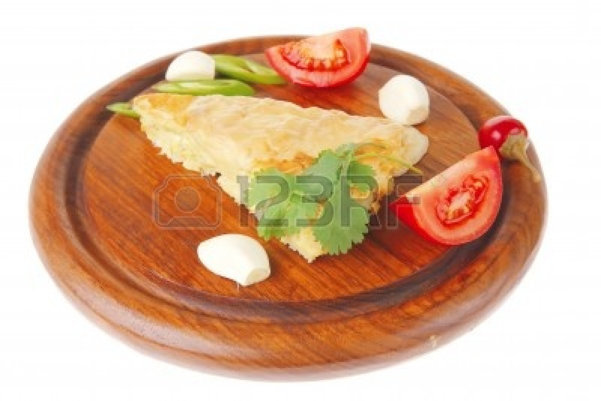 9881135-dairy-food-cheese-casserole-triangle-served-on-wood-plate-with-tomatoes-capers-and-chives-isolated