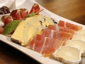 starter-plate-cheese-ham-brown-wood-table-23976614